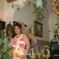 أنا أمينة من الجزائر 33 سنة مطلق(ة) و أبحث عن رجال ل الحب
