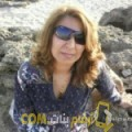 أنا خلود من ليبيا 54 سنة مطلق(ة) و أبحث عن رجال ل التعارف